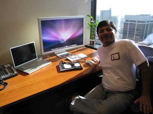 Ashish Jain with a Mac and an Information Card shirt